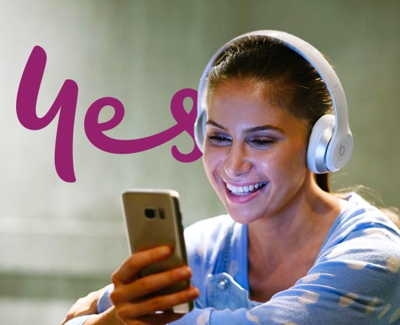 Girl with headphones on, smiling and watching entertainment on mobile phone - Optus