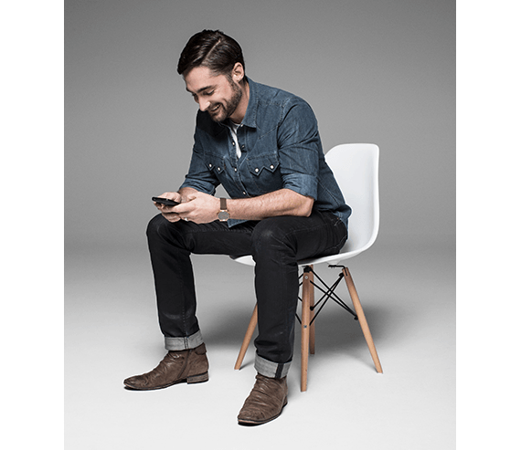 Optus photo of man looking at mobile phone